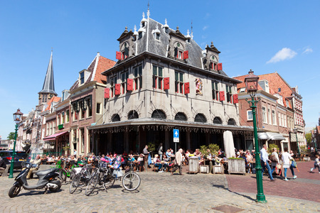 hoorn: HOORN, NETHERLANDS - MAY 15: Waag building at the central square on May 15, 2014 in Hoorn, The Netherlands. The City is founded in 716 and was an important VOC home base. Editorial