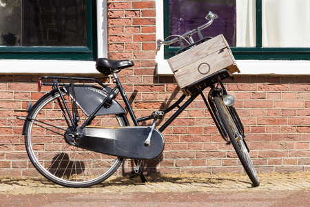 Dutch vintage bicycle against an old brick wall  photo