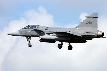 leeuwarden: LEEUWARDEN, THE NETHERLANDS - APRIL 20: Swedish Air Force SAAB J-39 Gripen landing during the exercise Frisian Flag 2012. Leeuwarden Airbase april 20, 2012 in Leeuwarden, The Netherlands  Editorial