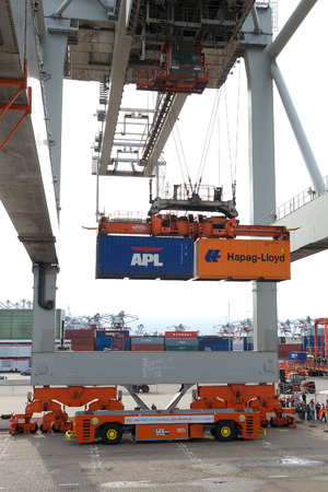 ROTTERDAM - SEP 8: Gantry crane operator moves containers on Sep 8, 2013 in Rotterdam, Netherlands. The port is the Europs largest and facilitate the needs of a hinterland with 40,000,000 consumers.