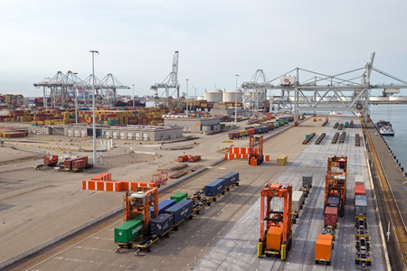 facilitate: ROTTERDAM - SEP 8: Container terminal and cranes on Sep 8, 2013 in Rotterdam, Netherlands. The port is the largest in Europe and facilitate the needs of a hinterland with 40,000,000 consumers.  Editorial