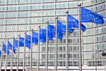 Flags in front of the EU Commission building in Brussels photo