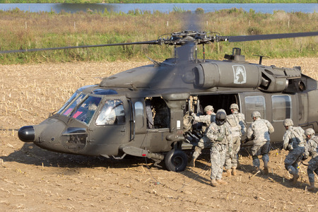 us soldier: Soldiers of the 82nd Airborne Division enter a Black Hawk helicopter.