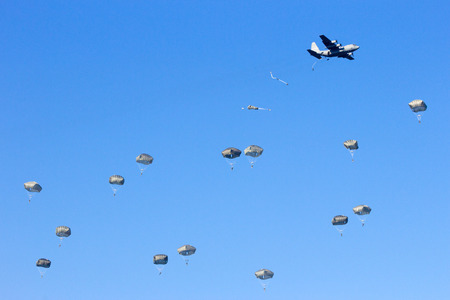 military invasion: Military planes drop paratroopers
