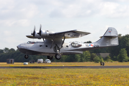 consolidated: GILZE-RIJEN, NETHERLANDS - JUNE 20: Consolidated PBY Catalina in Dutch Navy colors flying at the Royal Netherlands Air Force Days June 20, 2014 in Gilze-Rijen, Netherlands.