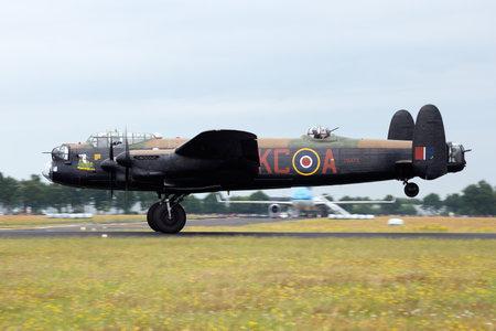 GILZE RIJEN, THE NETHERLANDS - JUNE 21: RAF Historical flight Lancaster WW2 plane flying on the Royal Dutch Air Force Open House. June 21, 2014 in Gilze-Rijen, The Netherlands