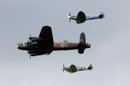 GILZE RIJEN, THE NETHERLANDS - JUNE 21: RAF Historical flight with a Lancaster and Spitfires flying on the Royal Dutch Air Force Open House. June 21, 2014 in Gilze-Rijen, The Netherlands