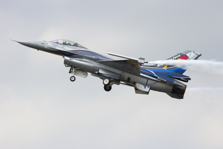 GILZE-RIJEN, THE NETHERLANDS - JUNE 20: Belgian Air Force F-16 solo display performing at the Dutch Air Force Open Day on June 20, 2014 in Gilze Rijen, The Netherlands