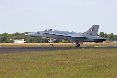 f18: GILZE-RIJEN, THE NETHERLANDS - JUNE 20: Swiss Air Force F-18 Hornet take off at the Dutch Air Force Open Day on June 20, 2014 in Gilze Rijen, The Netherlands