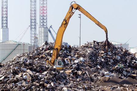 Scrap metal dump with crane. Stock Photo