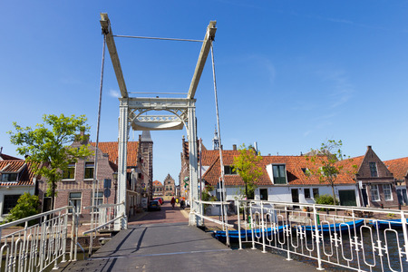 draw bridge: EDAM, THE NETHERLANDS - MAY 15: Draw bridge leading to rhe Carillon tower om May 15, 2014 in Edam. The tower houses the oldest clockwork in the Netherlands, dating from 1561