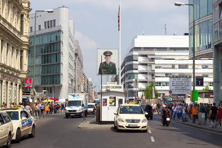 allied: BERLIN, GERMANY - MAY 23: Tourists around the former Allied checkpoint Editorial