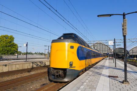 Train leaving Amsterdam Central Station.