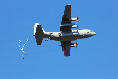 allied: GROESBEEK, NETHERLANDS - SEP 18: Hercules plane drops paratroopers from the 82AD at Market Garden memorial on Sep 18, 2014 in Groesbeek,Netherlan ds. Market Garden was a large Allied operation in 1944. Editorial
