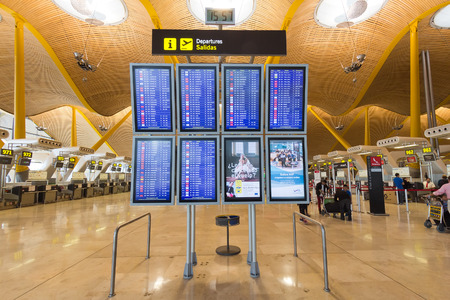 plane table: MADRID - OCT 11: Departures information boards at Madrid Barajas International Airport on Oct 11, 2014 in Madrid, Spain.  The airport is Spain