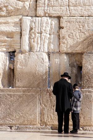 worshipers: JERUSALEM, ISRAEL - JANUARY 23: Jewish worshipers pray at the Wailing Wall January 23, 2011 in Jerusalem, Israel.