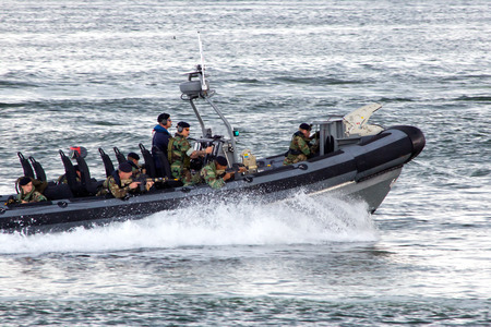 anti piracy: DEN HELDER, THE NETHERLANDS - JULY 7: Dutch Marines in a speedboat during an assault demo at the Dutch Navy Days on July 7, 2012 in Den Helder, The Netherlands
