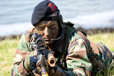amphibious: DEN HELDER, THE NETHERLANDS - JULY 7: A Dutch Marine during an amphibious assault demo during the Dutch Navy Days on July 7, 2012 in Den Helder, The Netherlands