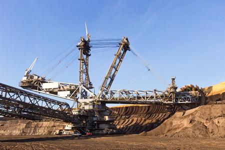 pit: Bucket wheel excavator in a brown coal open pit mine. Stock Photo