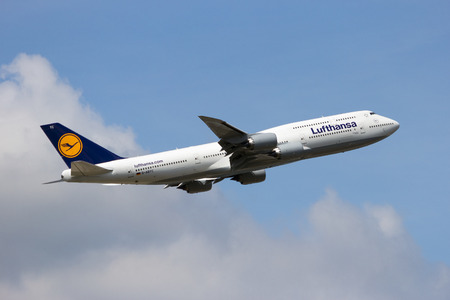 boeing: FRANKFURT, GERMANY - JUL 09, 2013: A Lufthansa Boeing 747-830 taking off from Frankfurt Airport. Lufthansa is founded in 1953 and the largest airline in Europe.