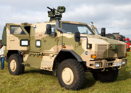 car carrier: LAAGE, GERMANY -  AUG 23, 2014: A German Army ATF KMW Dingo 2 on display during the Laage airbase open house. The ATF Dingo is a German heavily armored military infantry mobility vehicle.