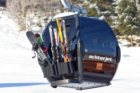 wintersport: FLACHAU, AUSTRIA - DEC 29: Ski lift cable booth going up the piste in Flachau, Austria on Dec 29, 2012. These pistes are part of the Ski Armada network, the largest of Europe.