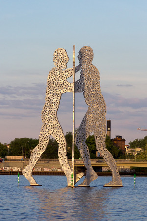 treptow: BERLIN - MAY 21, 2014: Molecule Man designed by Jonathan Borofsky, on May 21, 2014 in Berlin, Germany. Symbol of the unity of the three restructured in the 2001 district Treptow and Friedrichshain