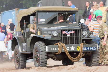 allied: EDE, NETHERLANDS - SEP 20, 2014: Dodge WC-56 Command Car in a parade during the Market Garden Memorial. Operation Market Garden was a large Allied military operation in September 1944.