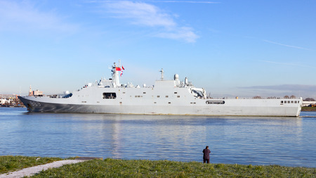 destroyer: ROTTERDAM - JAN 30, 2015: The Chinese PLA Navy amphibious transport ship Changbai Shan (989) leaving the Port of Rotterdam after the first visit ever of the Chinese PLA Navy to The Netherlands.