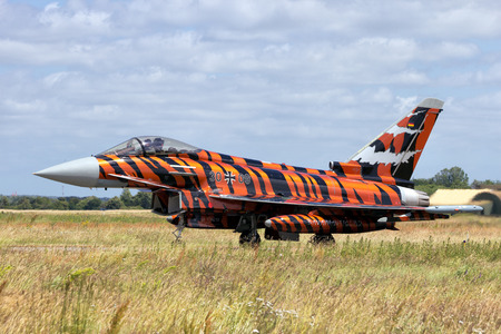 nato: SCHLESWIG-JAGEL, GERMANY - JUN 23, 2014: Tiger painted German Air Force Eurofighter Typhoon during the NATO Tiger Meet at Schleswig-Jagel airbase. The Tiger Meet is to promote solidarity between NATO air forces