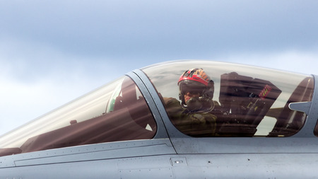 fighter pilot: SCHLESWIG-JAGEL, GERMANY - JUN 23, 2014: French Air Force Rafale pilot close up during the NATO Tiger Meet at Schleswig-Jagel airbase. The Tiger Meet is to promote solidarity between NATO air forces