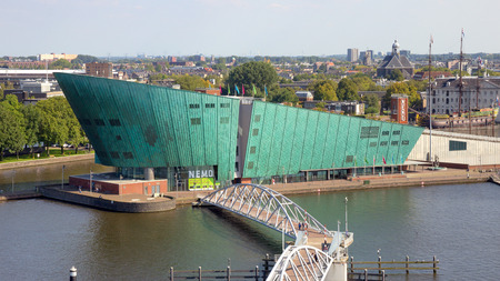 nemo: AMSTERDAM - AUG 27, 2014: The Nemo Museum in Amsterdam, Netherlands. Science Center NEMO is a science center designed by Renzo Piano since 1997. Editorial