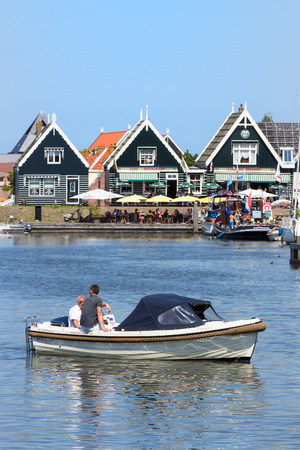 marken: MARKEN, HOLLAND - JUL 26, 2012: Boat entering the marina in the touristic town of Marken, Holland