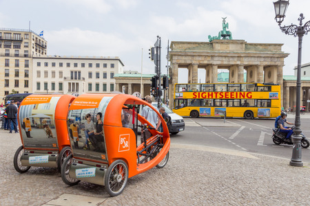 BERLIN, GERMANY - MAY 23: Taxi bikes in front of the Brandenburger Tor on May 23, 2014 in Berlin, Germany. 5,334 kilometres of roads run through the city of Berlin.