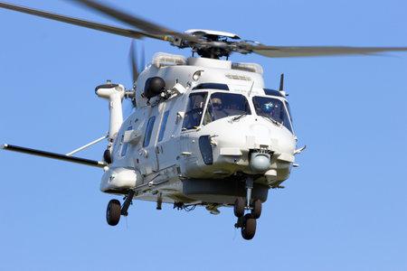 heli: GILZE RIJEN, THE NETHERLANDS - JUNE 21: Belgian Navy NH90 take off during the Dutch Air Force Open House. June 21, 2014 in Gilze-Rijen, The Netherlands