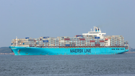 facilitate: ROTTERDAM - SEP 6: Maersk container ship leaving the port on Sep 6, 2013 Rotterdam, Netherlands. This port is the largest in Europe and facilitate the needs of a hinterland with 40,000,000 consumers.