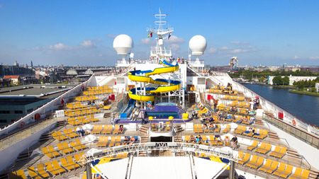 luxery: AMSTERDAM - SEP 2, 2014: Deck on the Costa Fortuna cruise ship with a view over Amsterdam. The ship is part of a fleet of 17 ships owned by Costa Cruises. Editorial
