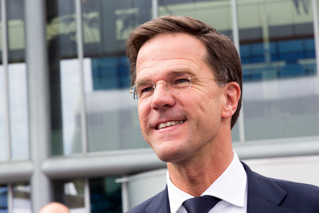 AMSTERDAM - APRIL 16, 2015: Dutch Prime Minister Mark Rutte arriving in an old Police Porsche for the opening of the AutoRAI 2015.
