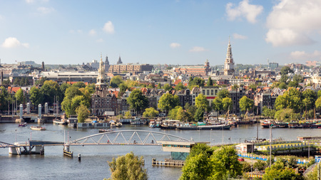 AMSTERDAM - SEP 2, 2014: City view of Amsterdam. The city is known as Venice of the North, its canal belt was finally added to the world heritage list in July 2010.