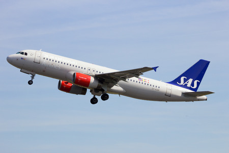 airborne vehicle: AMSTERDAM - APRIL 21, 2015: Scandinavian Airlines (SAS) Airbus A320-200 taking off from Amsterdam-Schiphol airport. SAS is the largest airline in Scandinavia and flag carrier of Sweden, Norway and Denmark.