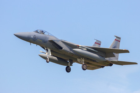 us air force: LEEUWARDEN, NETHERLANDS - APRIL 15, 2015: US Air Force F-15 Eagle landing during the exercise Frisian Flag. The exercise is considered one of the most important NATO training events this year.
