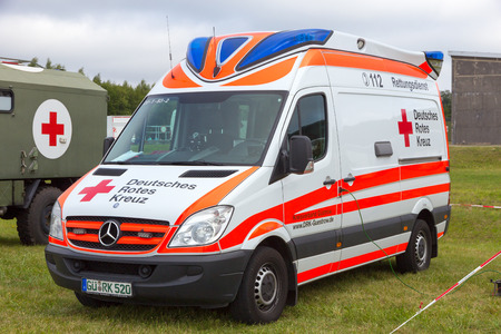 cross street with care: LAAGE, GERMANY - AUG 23, 2014: A German Red Cross ambulance at the Laage airbase open house.