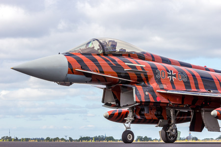 nato: SCHLESWIG-JAGEL, GERMANY - JUN 23, 2014: German Air Force Eurofighter Typhoon during the NATO Tiger Meet at Schleswig-Jagel airbase. The Tiger Meet is to promote solidarity between NATO air forces