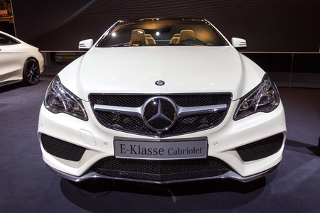 configurations: AMSTERDAM - APRIL 16, 2015: Mercedes-Benz E-Class Cabriolet car at the AutoRAI 2015. E-class is a range of executive cars manufactured by Mercedes-Benz in various engine and body configurations produced since 1993.
