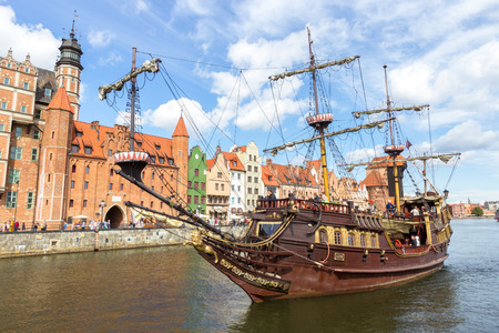 gdansk: GDANSK, POLAND - AUGUST 21, 2014: Galeon Lew cruise arriving at the city of Gdansk. The city is the historical capital of Polish Pomerania with medieval old town architecture.