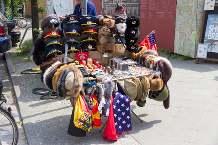 allied: BERLIN, GERMANY - MAY 23, 2014: Sale stand of Soviet and DDR militaria near Checkpoint Charlie in Berlin, Germany.