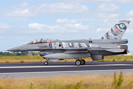 nato: SCHLESWIG-JAGEL, GERMANY - JUN 23, 2014: Polish Air Force F-16 fighter jet during the NATO Tiger Meet at Schleswig-Jagel airbase. The Tiger Meet is to promote solidarity between NATO air forces