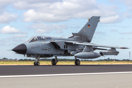 aircraft bomber: SCHLESWIG, GERMANY - JUN 23, 2014: German Air Force Tornado from AG-51 taxiing at the NATO Tiger Meet at Schleswig-Jagel airbase. The Meeting Meet is to promote solidarity between NATO air forces
