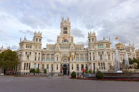 old town square: MADRID, SPAIN - OCTOBER 10, 2014: The Cibeles Palace in Madrid. The palace and the fountain in front are symbolic monuments of the city.