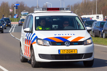 patrolling: LEEUWARDEN, NETHERLANDS - 15 APRIL, 2015: A Dutch Volkswagen Touran on patrol. The police are the largest corporate purchaser of the Volkswagen Touran in the Netherlands. Editorial